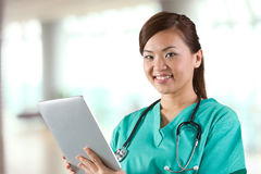 Female doctor holding a digital tablet. Royalty Free Stock Photography