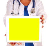 Female doctor holding digital tablet isolated on white backgroun Stock Photo