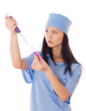 Female doctor holding a doser and tube in her hand. Stock Photo