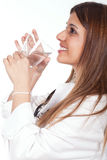 Female doctor holding and drinking water Royalty Free Stock Image