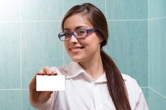 A female doctor holding an empty card Stock Image