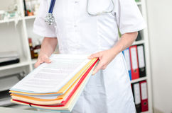Female doctor holding files Stock Photography