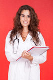 Female doctor holding a folder and stethoscope Stock Image