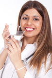 Female doctor holding a glass of water Stock Photography