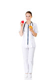 Female doctor holding healthy grapefruit and red heart. Stock Images