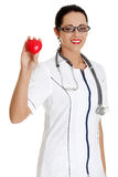 Female doctor holding heart Royalty Free Stock Photos