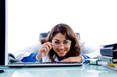 Female doctor holding her eye wear Royalty Free Stock Image
