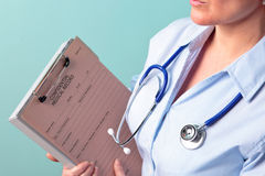 Female doctor holding medical record Royalty Free Stock Photo