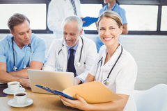 Female doctor holding a medical report Royalty Free Stock Photos