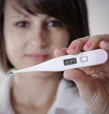 Female Doctor Holding Medical Thermometer Stock Image