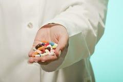 Female doctor holding medicine Stock Image