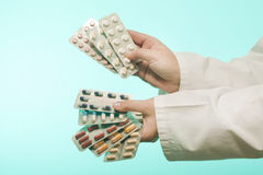 Female doctor holding medicine. Studio shot stock photo