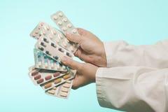 Female doctor holding medicine. Studio shot stock image