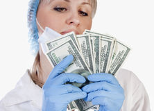 Female doctor holding money Stock Photography