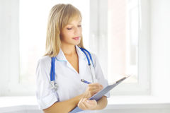 Female doctor holding a notepad Stock Image