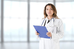 Female Doctor Holding a Pad Stock Photos