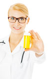 Female Doctor Holding Pill Bottle Over White Background Royalty Free Stock Photography