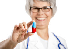 Female doctor holding  a pill Stock Images