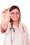 female doctor holding a pill in her hand Royalty Free Stock Photos