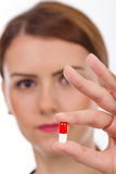 Female doctor holding pill Stock Photos