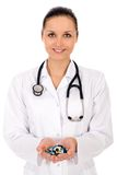 Female doctor holding pills Royalty Free Stock Photography