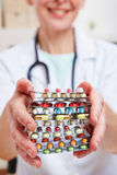 Female doctor holding pills in her Royalty Free Stock Image