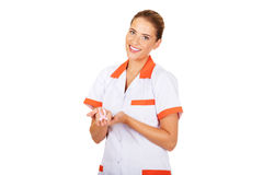 Female doctor holding pink breast cancer awareness ribbon Stock Images