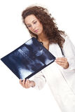 Female doctor holding a radiography Royalty Free Stock Images