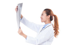 Female doctor holding x-ray or roentgen image. Stock Image