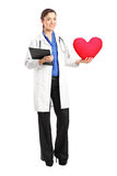 Female doctor holding a red heart Stock Photo