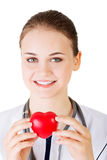Female doctor holding red heart in hand. Stock Photography
