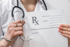Female doctor holding rx paper Royalty Free Stock Photos