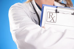 Female doctor holding rx Royalty Free Stock Image