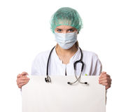Female doctor holding a sign Royalty Free Stock Image