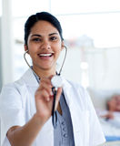 Female doctor holding a stethoscope Stock Photo