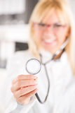 Female doctor holding stethoscope Stock Photos