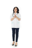 Female doctor holding stethoscope Royalty Free Stock Photos