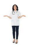 Female doctor holding stethoscope Royalty Free Stock Image