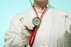 Female doctor holding a stethoscope Stock Photography