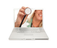 Free Female Doctor Holding Stethoscope Thru Screen Royalty Free Stock Image - 14561076