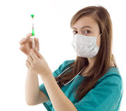Female doctor holding syringe Royalty Free Stock Images