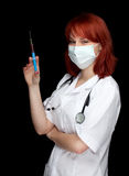 Female doctor holding a syringe Royalty Free Stock Images