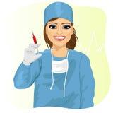 Female doctor holding a syringe Stock Photo