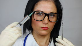 Female doctor holding syringe Royalty Free Stock Image