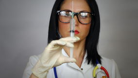 Female doctor holding syringe Stock Photo