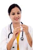 Female doctor holding syringe royalty free stock photography