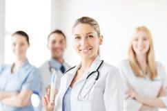Female doctor holding syringe with injection Stock Image