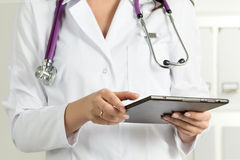 Female Doctor Holding Tablet PC Stock Image