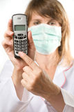 Female doctor holding telephone Royalty Free Stock Photos