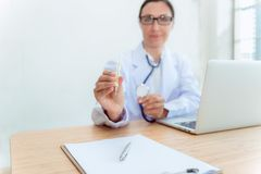 Female doctor holding a thermometer ready to health check up in Royalty Free Stock Images